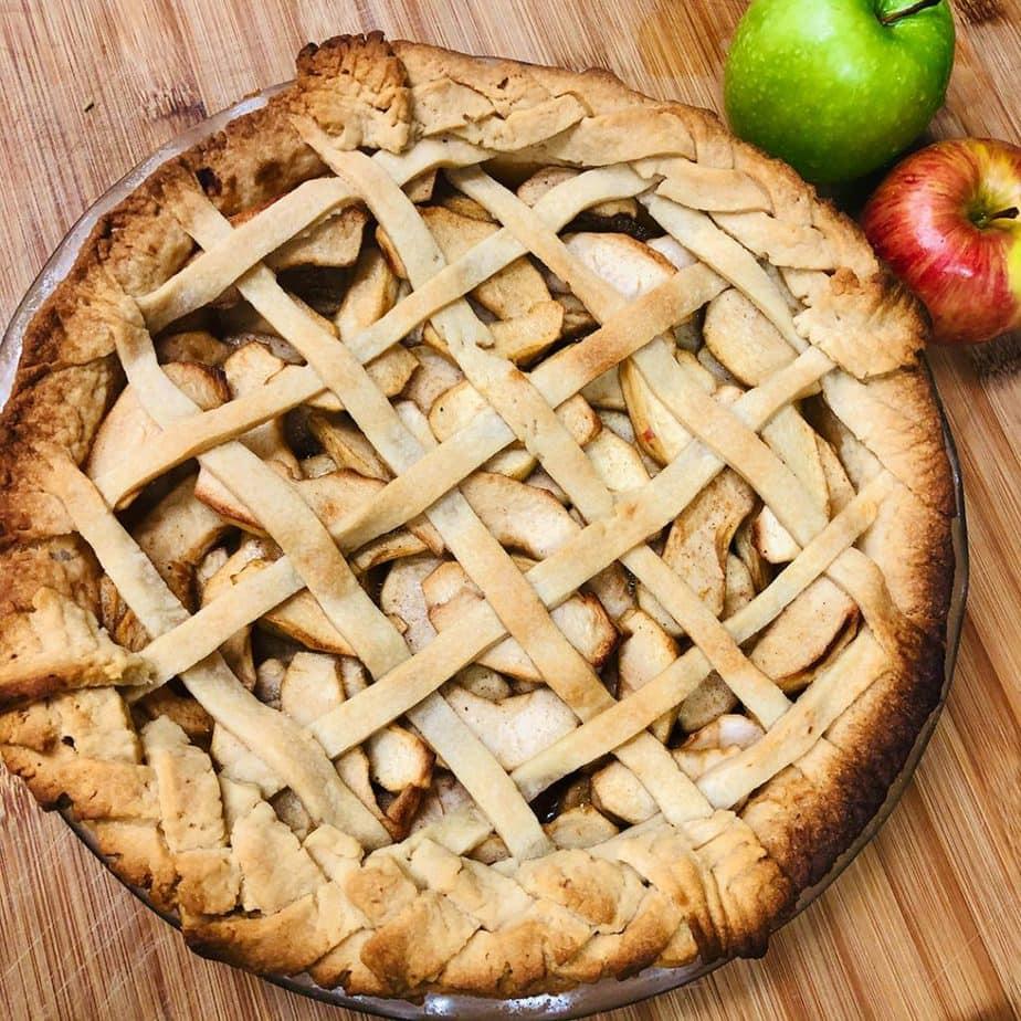 A baked vegan apple pie with a decorative lattice pie crust.