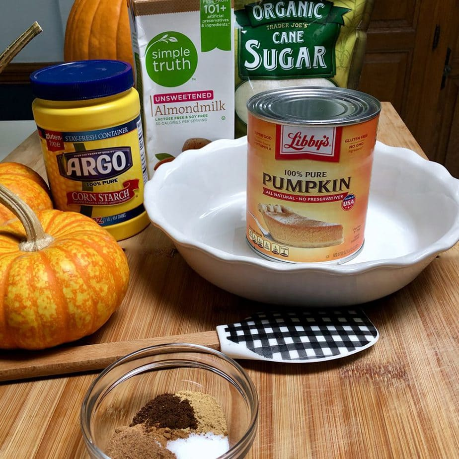 Vegan pumpkin pie ingredients with almond milk.
