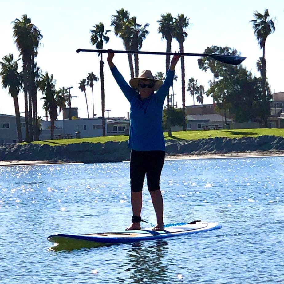 Vegan blogger and creator of The Carrot Underground, Connie Edwards McGaughy ,riding a stand up paddle board at Mission Bay in San Diego, CA.