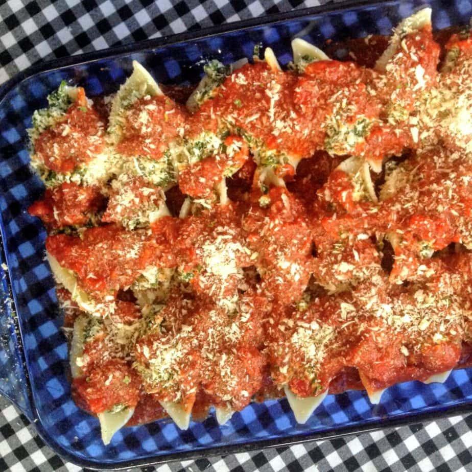vegan spinach & cheese stuffed shells topped with homemade marinara sauce