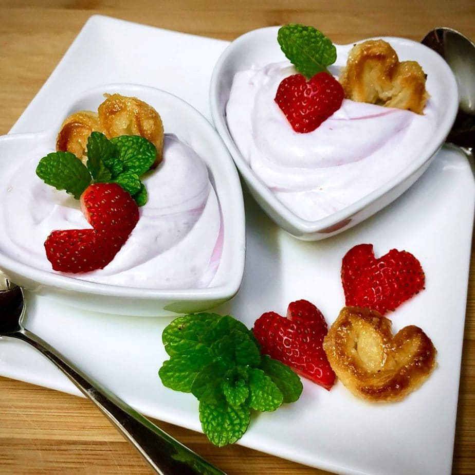vegan berry mousse in heart shaped bowls with mini palmier pastries