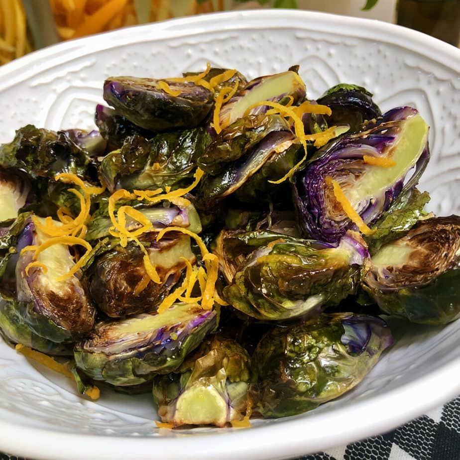 Roasted purple Brussels sprouts with orange sauce.