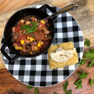 vegan chili and cornbread with chile lime butter