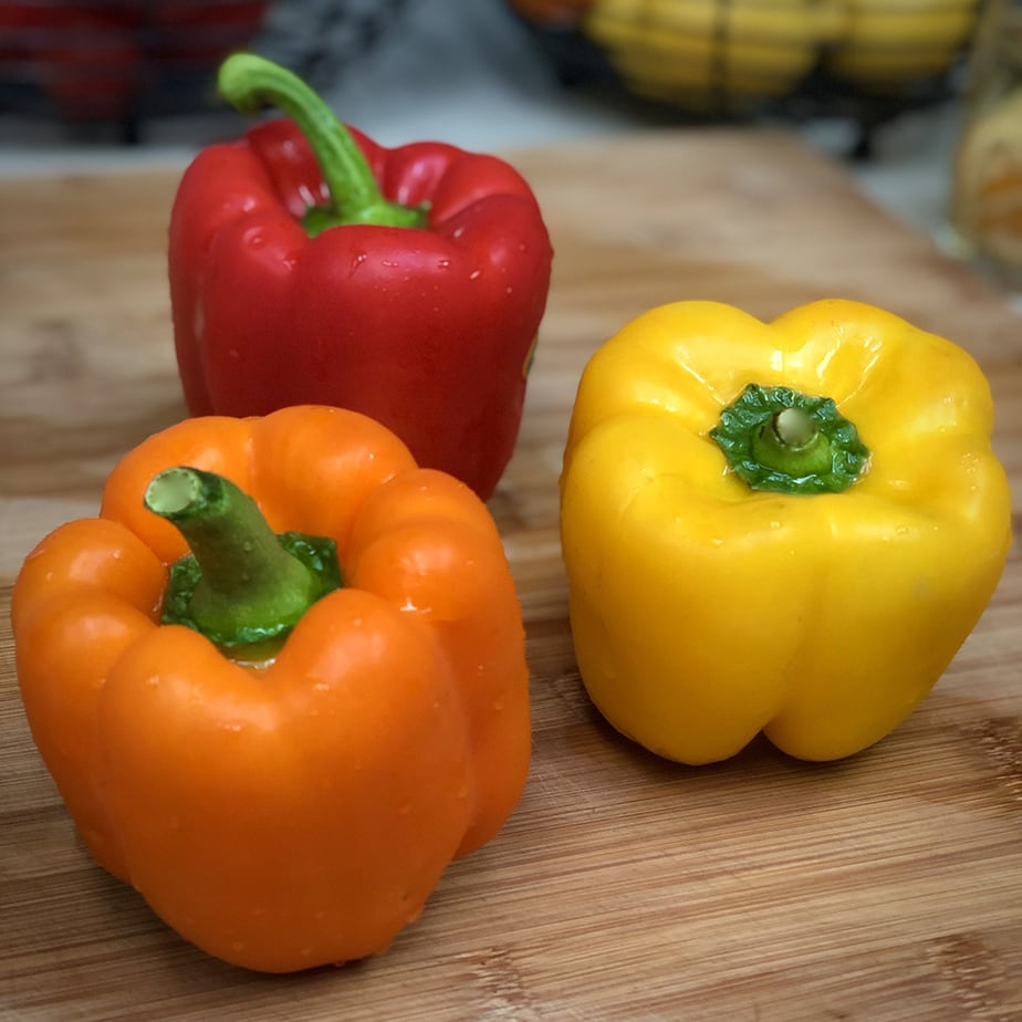 Red, orange and yellow bell peppers.
