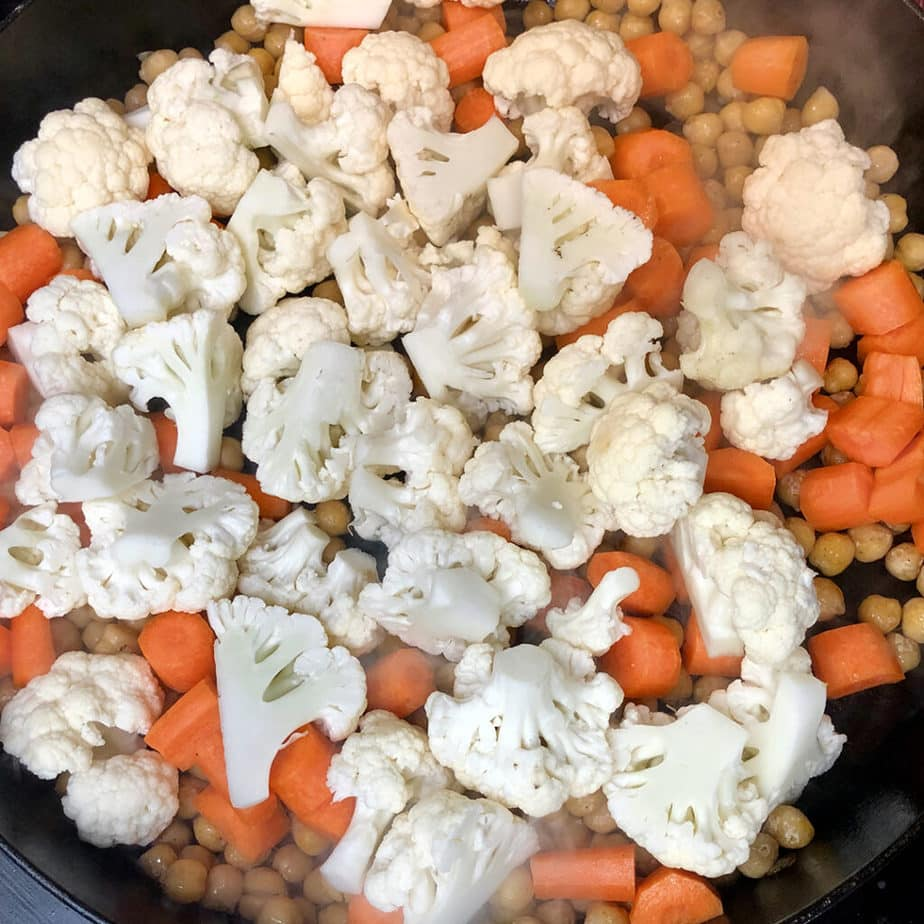 cauliflower chickpeas and carrots in skillet