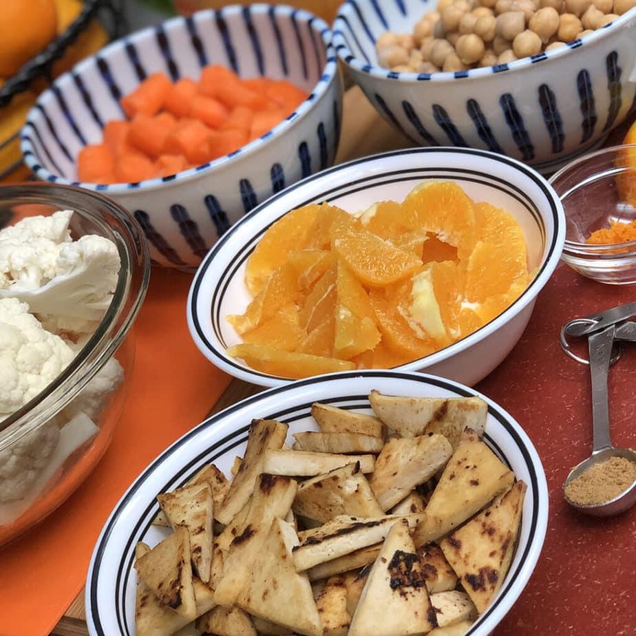cauliflower, tofu, oranges, chickpeas, carrots
