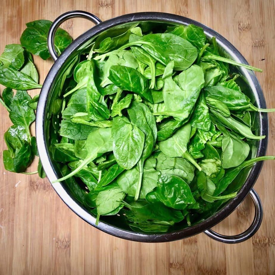 fresh spinach inside colander