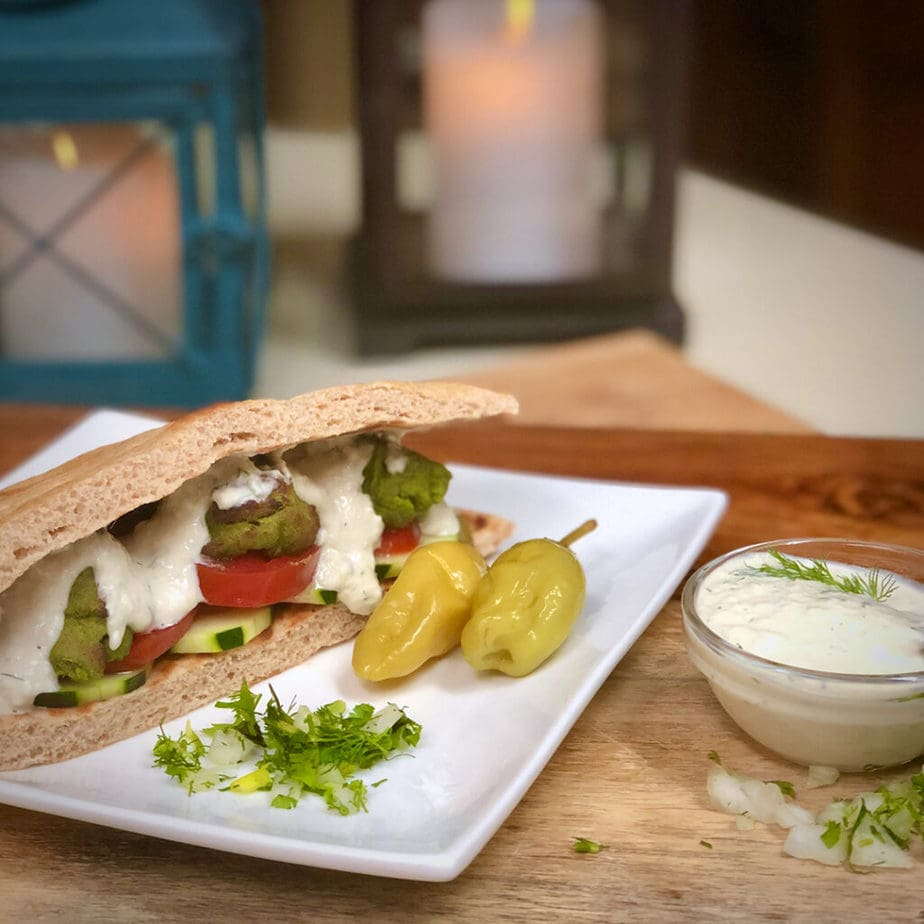 vegan falafel sandwich with tzatziki sauce