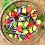 watermelon salad with red onion, cucumber, avocado and basil