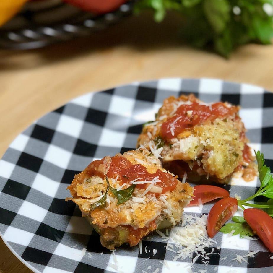 two vegan zucchini ravioli on plate