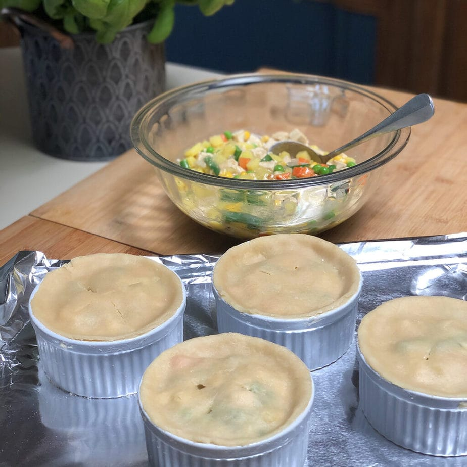unbaked vegan pot pies on baking sheet