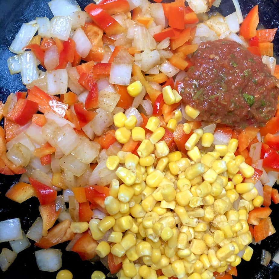 onions, peppers, corn & salsa in pan