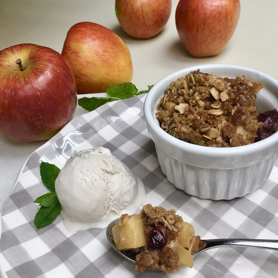 apples and vegan apple crisp plated with ice cream