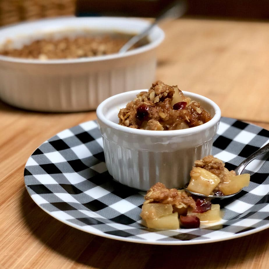 apple crisp on plate with spoon
