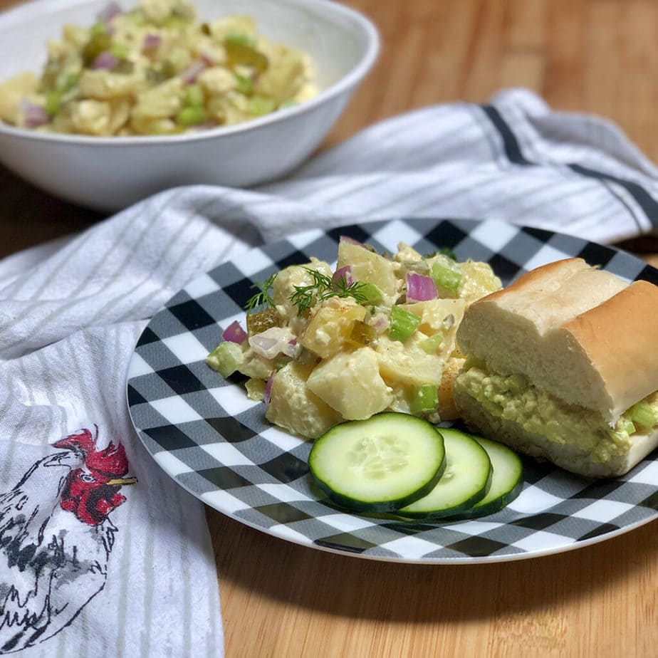 grandma's old fashioned vegan potato salad and egg sandwich on plate