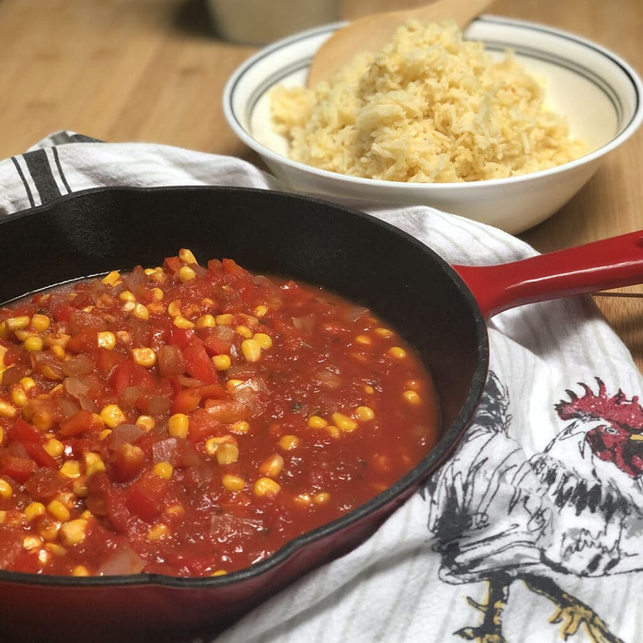 spanish rice sauce in pan and cooked rice