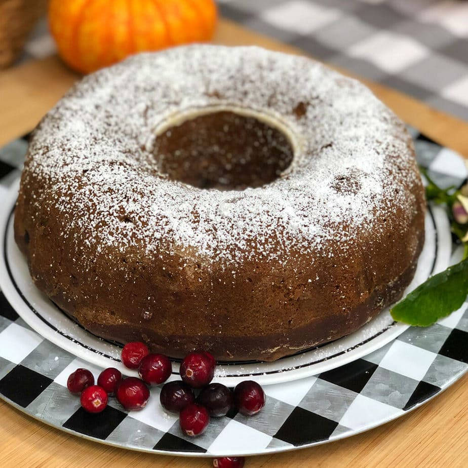 Old fashioned vegan applesauce cake on a tray.