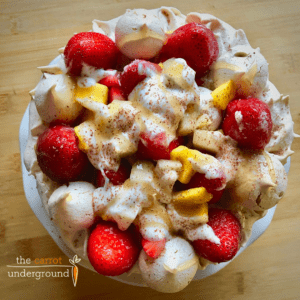 vegan meringue pavlova dessert with strawberries and mango