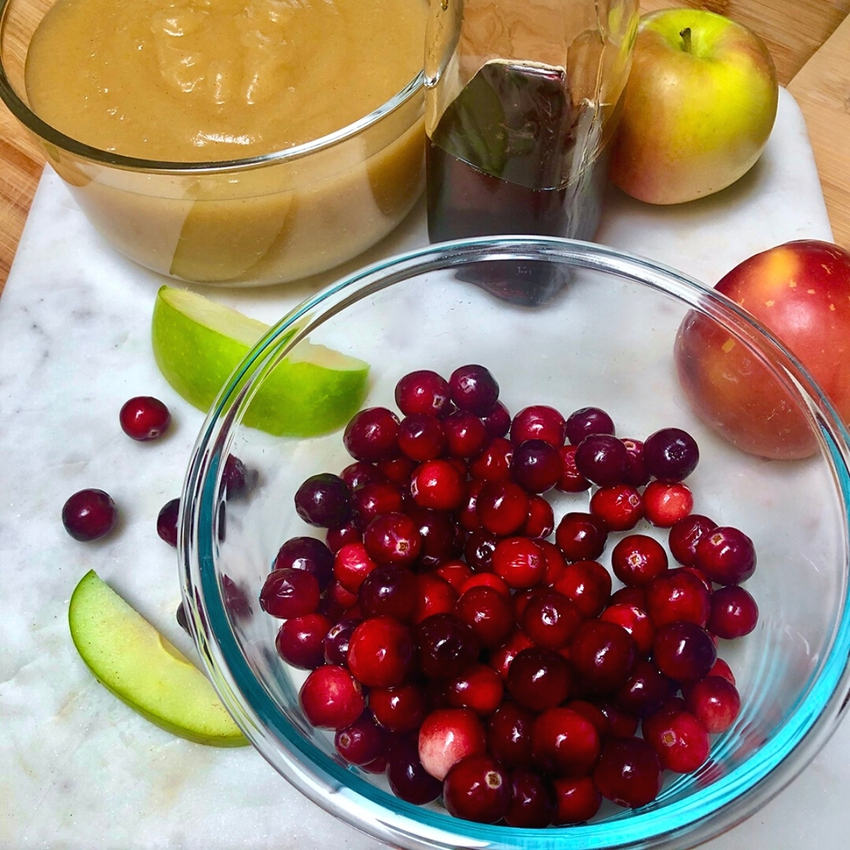 Ingredients for homemade cranberry applesauce.