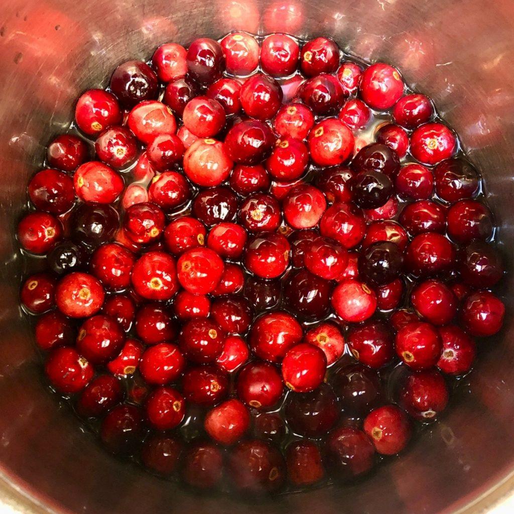 Fresh cranberries in a pan.