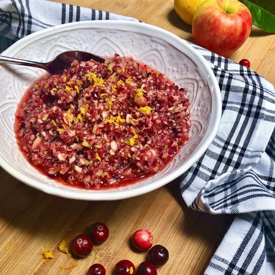 A bowl filled fresh cranberry relish.