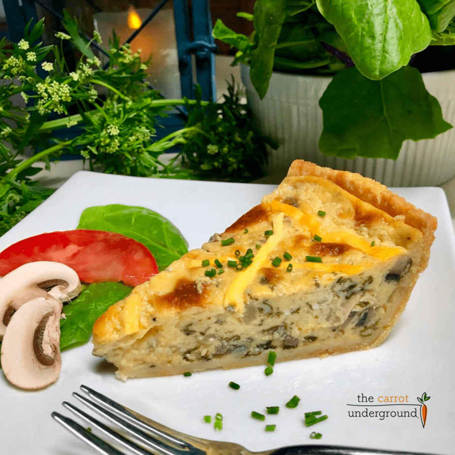 a slice of the best vegan spinach mushroom quiche