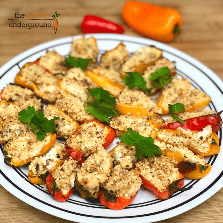 A plate with vegan popper poppers filled with vegan cheese and toasted breadcrumbs.