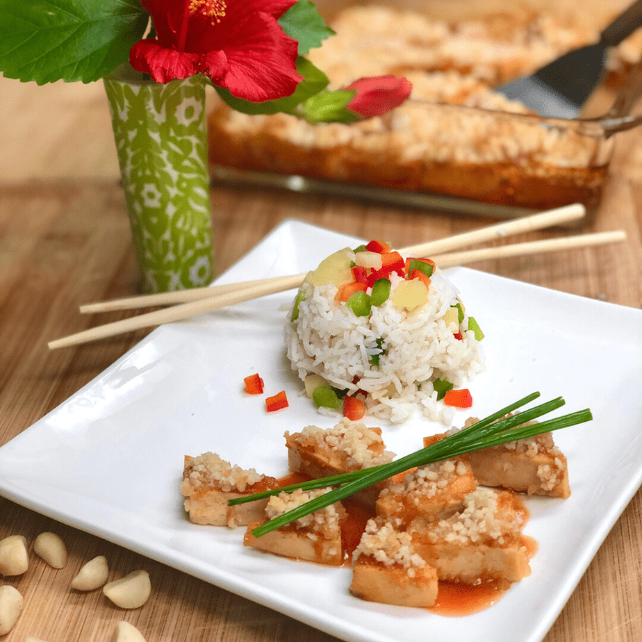 sweet & sour macadamia tofu with steamed rice on a plate