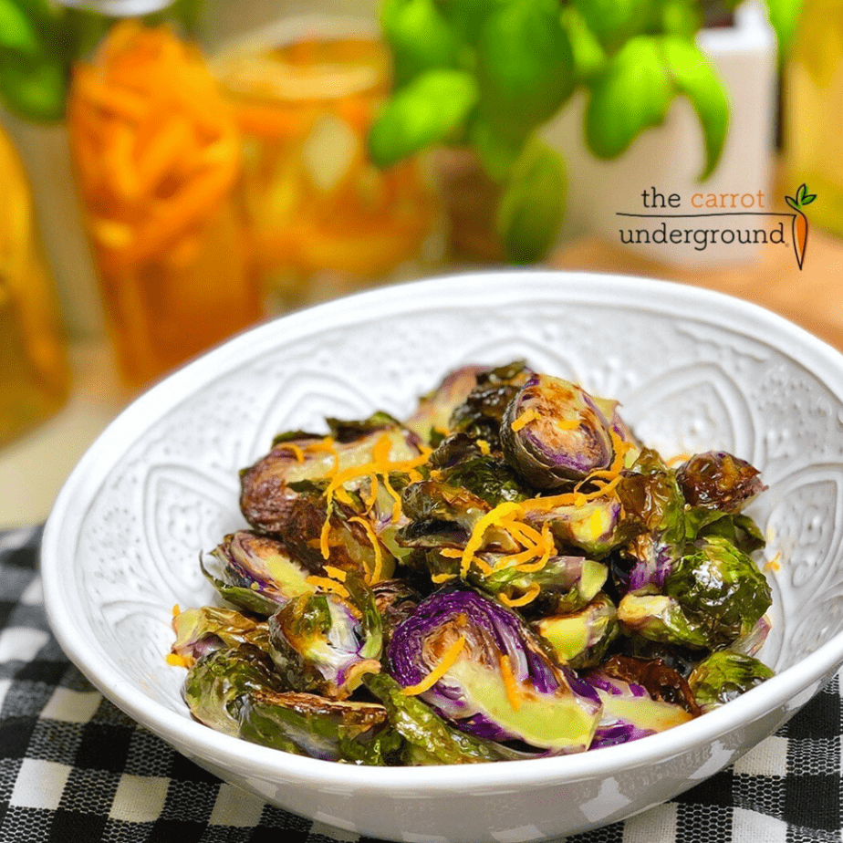 A bowl of orange balasamic roasted purple brussels sprouts