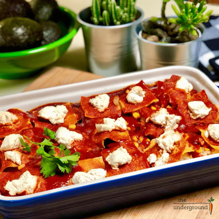 vegan potato enchilada casserole topped with vegan cheese