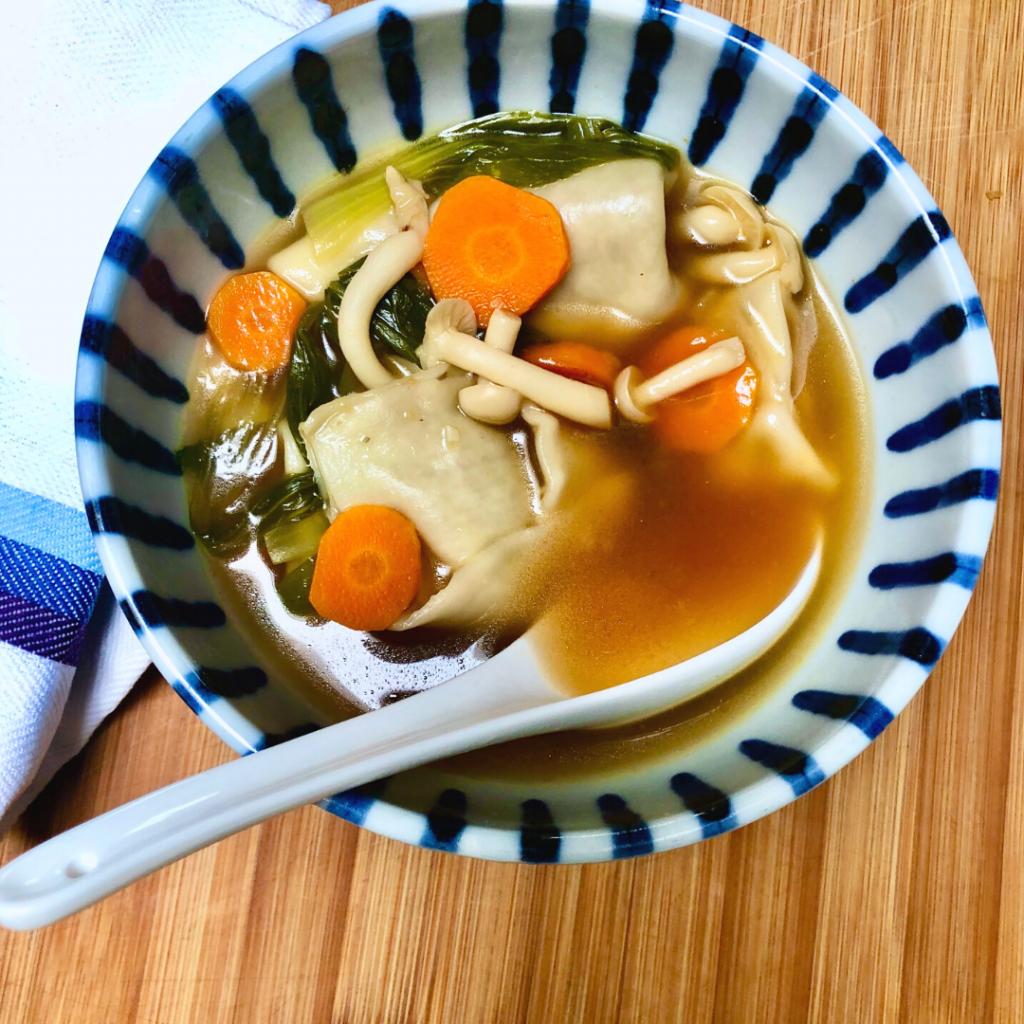 A bowl of homemade vegan wonton soup.