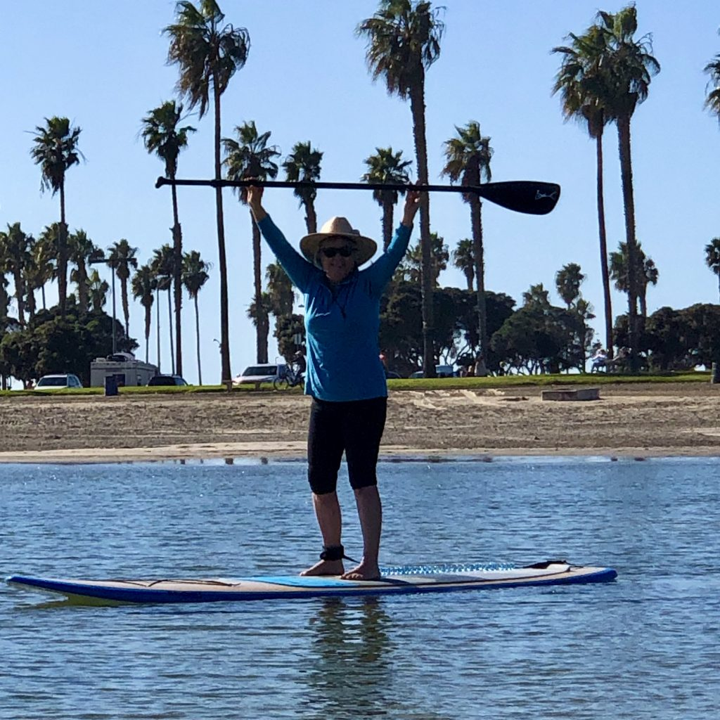 Connie Edwards McGaughy on paddle board in South Mission Beach
