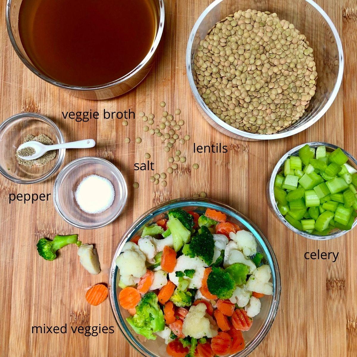 Ingredients for vegan lentil soup, including lentils, broccoli, cauliflower, carrots, celery, broth, salt and pepper.