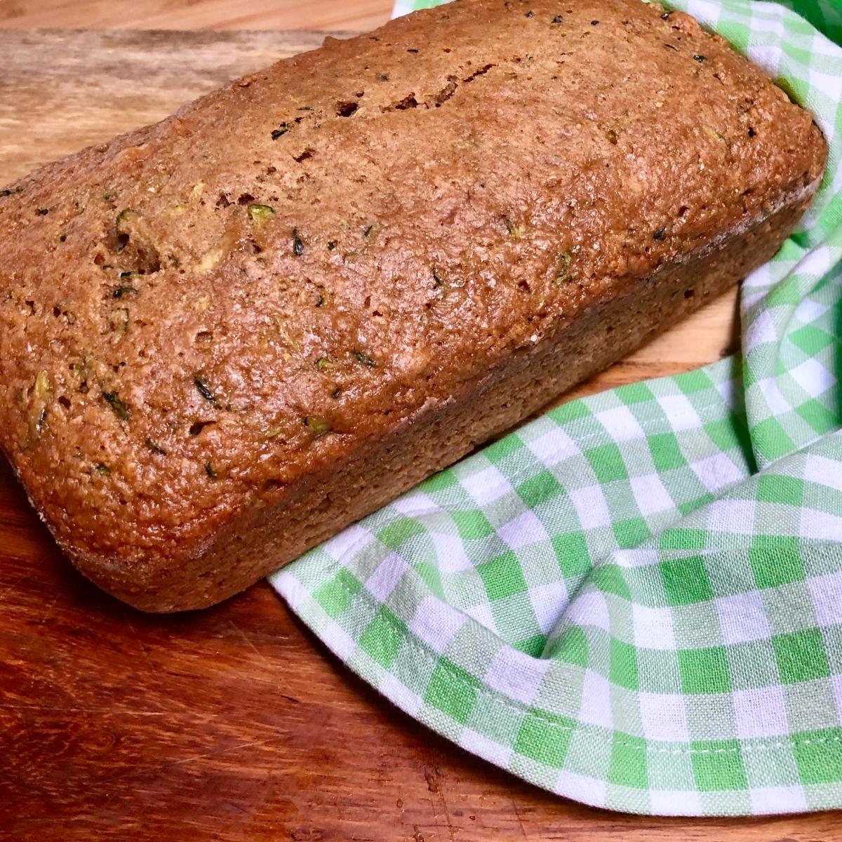 Loaf of freshly baked vegan zucchini bread.