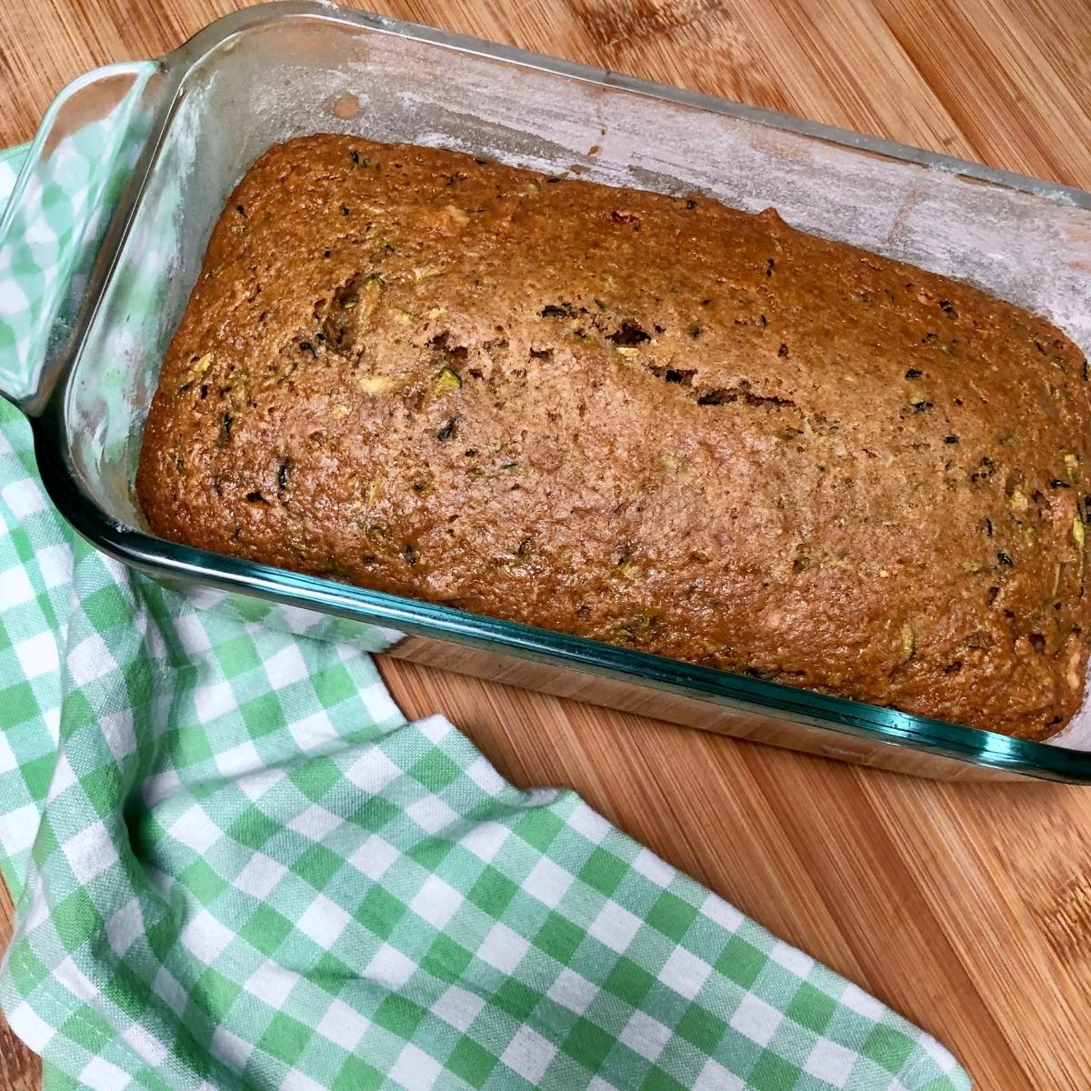 Baked vegan zucchini bread inside loaf pan.