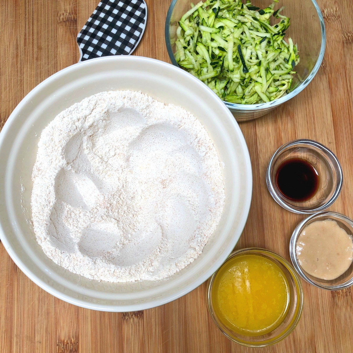 Simple vegan zucchini bread dry ingredients in a bowl with well.