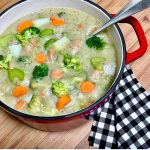 A pot filled with the best vegan creamy broccoli soup.