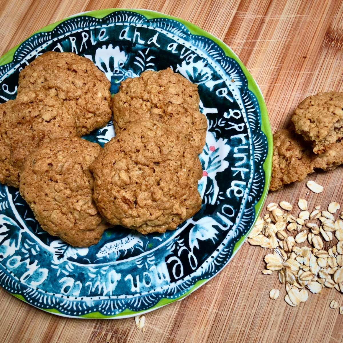 Vegan oatmeal cookies arranged on a decorative plate.